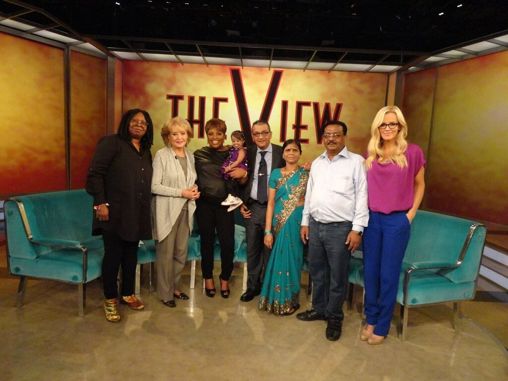 Mr. Dinesh Govindani and the Amge family with hosts of American TV Show The View