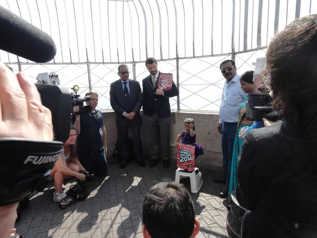 Mr. Dinesh Govindani with Stuart E. F. Claxton, a representative from the Guinness Book of World Records along with Jyoti Amge at the top of The Empire State Building