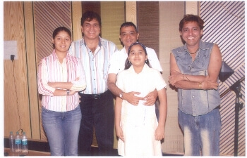 Dinesh and Twinkle Govindani with Singer Sukhwinder Singh & Sunidhi Chouhan during composition of a song for the film Monopoly