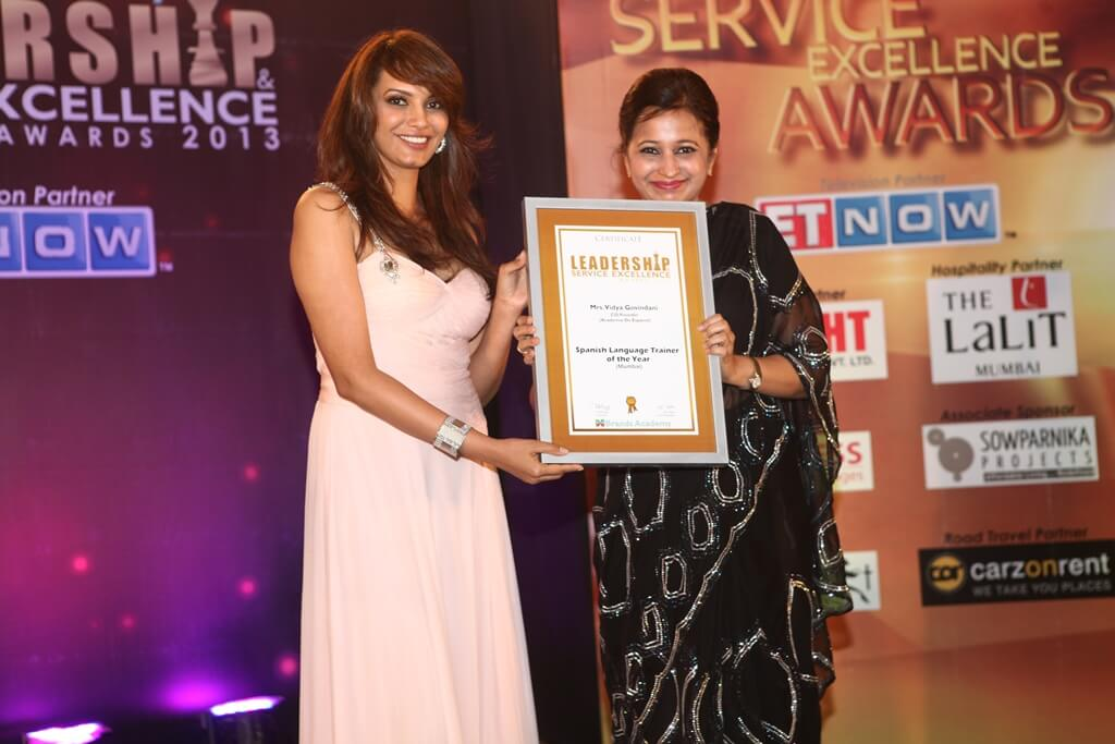 Mrs. Vidya Govindani being awarded the certificate for the Spanish Language Trainer of the Year 2013 in Mumbai by Diana Hayden