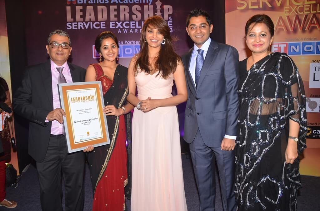 The Govindani family posing with the certificate awarded by Diana Hayden